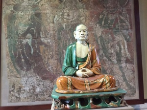 A photograph of an ancient asian scholar in the British Museum.