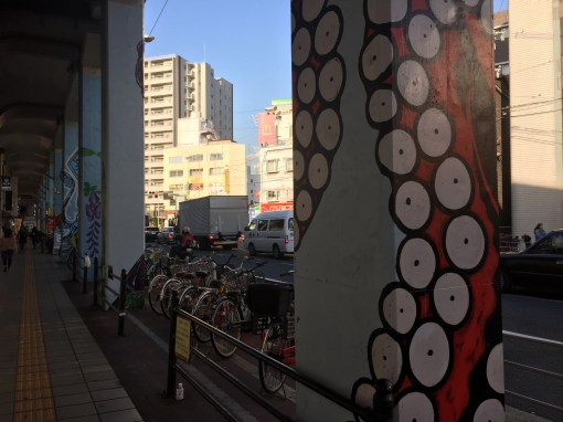 Graffiti in Osaka, Japan, featuring an octopus arm.